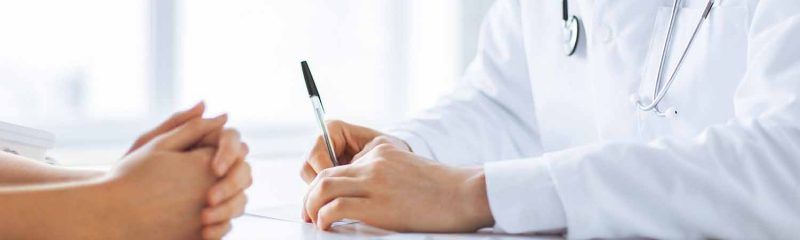 Doctor-with-pen-patient-with-hands-clasped-1500x800-px